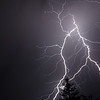 """E"" is for Electric   Lightning during a night storm."
