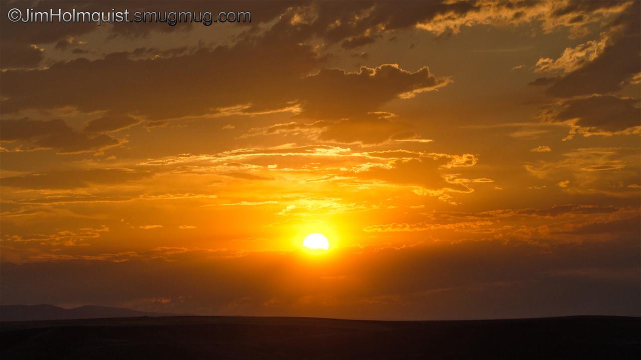 Sunset - Smoke from nearby fires covering sun near Kuna, Id. Taken in 2012.