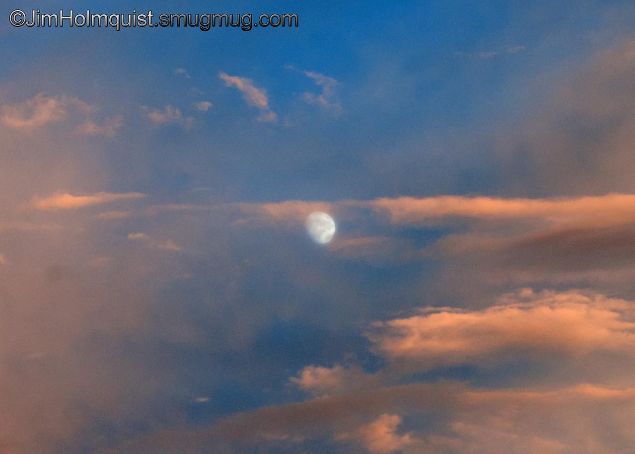 Moon - through the clouds at dusk near Idaho Falls, Id